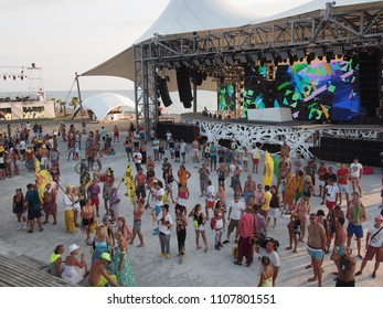 Anaklia, Georgia - August 26, 2014: People gather for a party on the main dance floor of the Kazantip Z'22 festival.
