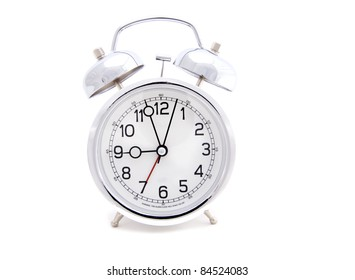 Analog Alarm Clock with time approaching 9 0'clock