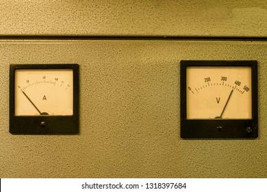 Analog ampere meter or amp meter and analog voltmeter.
