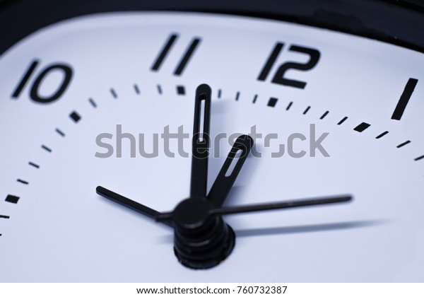 analog clock. clock about to 12 midnight or midday, conceptual of New Year and countdown. close up.