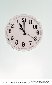 Analog Clock with backwards numbers for turning time back and daylight saving