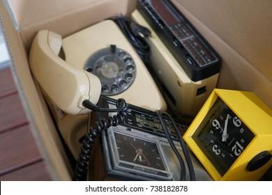 Analog to digital: old radios, rotary phone, alarm clock. Vintage