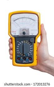 Analog multimeter in technician's hand