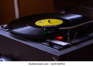 Analog retro technology: a 12-inch LP vinyl record rotating around the needle of the gramophone record player and reproducing german classical music with high-fidelity and true quality of sound