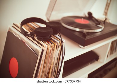 Analog Stereo Turntable Vinyl Record Player. Vinyl collection. Headphones