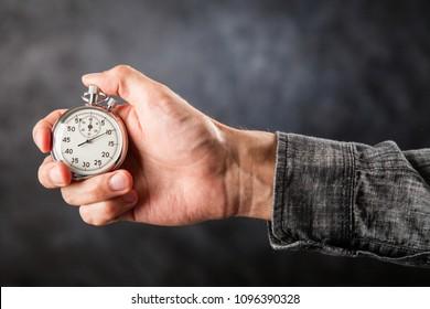 Analog stopwatch on black background
