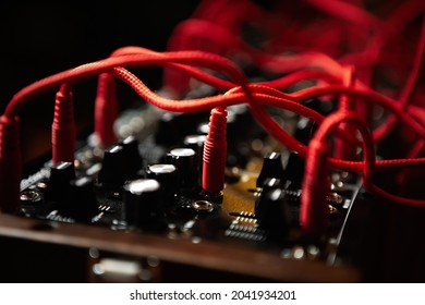 Analog synthesizer with audio cables. Professional modular synth device for electronic music production in sound recording studio