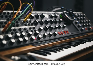 Analog synthesizer board in sound recording studio.Professional hi-fi audio equipment for music producer.Retro analog synth device for producing new musical tracks in high quality
