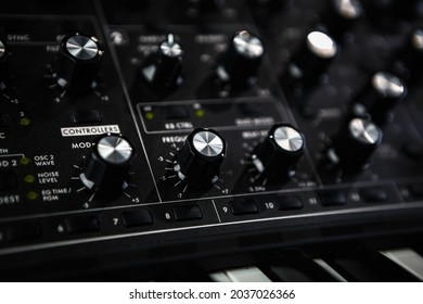 Analog synthesizer device. Professional audio equipment for electronic music production in sound recording studio.