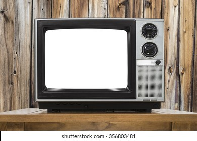 Analog television with cut out screen and rustic wod wall.