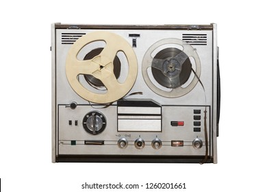 Analog vintage stereo reel tape deck recorder player with metallic reels isolated on white background.