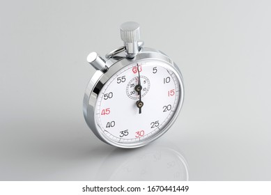Analogue metal stopwatch on the gray background.