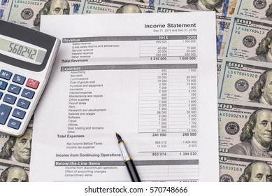 analysis of the annual budget with calculator and money on the table. financial concept.