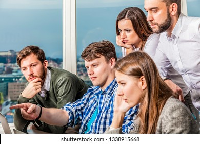 analyst business team solves a problem discussing it together. programmer shows with index finger onto screen. worst case management concept.