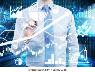 Analyst is drawing a financial calculations and predictions on the glass screen. Graphs, charts and arrows everywhere. A concept of forex market.