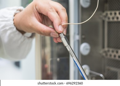 Analyst is working in laboratory with connecting HPLC column to the HPLC system before install to column oven, concept of qc laboratory in pharmaceutical industry .