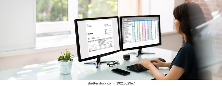 Analyst Working With Spreadsheet On Computer Screen