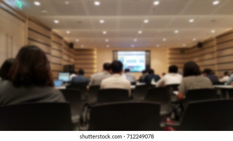 Analysts and Investors in the meeting conference room. Investor relations activities concept. Blurred background.