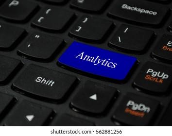 Analytics text written on a keyboard