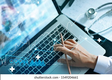 Analyzing data and growth chart healthcare business graph  and medical examination on laptop screen.