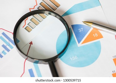 Analyzing and gathering statistical data. Growth charts. Many business reports and magnifying glass. Search statistics.