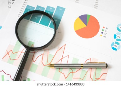 Analyzing and gathering statistical data. Growth charts. Business reports and magnifying glass.