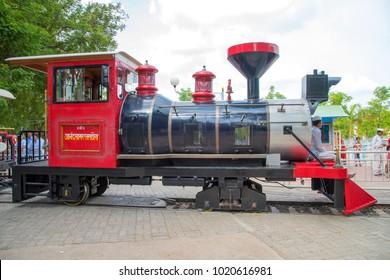 ANAND SAGARA SHEGAON, MAHARASHTRA, INDIA, 10 JULY 2017 : Unidentified tourist enjoy mini train at Anand Sagar Shri Saint Gajanan Maharaj Sansthan. Anand Sagar is tourist attraction place of Shegaon