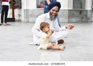 anandpur sahib, PUNJAB/INDIA - April 16,2019: indian kid doing yoga with his sikh grand father and enjoying the moment