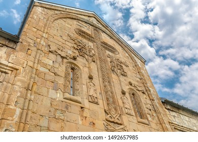 Ananuri, Georgia, 07.20.2019. Ananuri fortress, decorative stone carving on the wall of the Church of the assumption of the blessed virgin Mary, images of the cross, angels, vines and animals