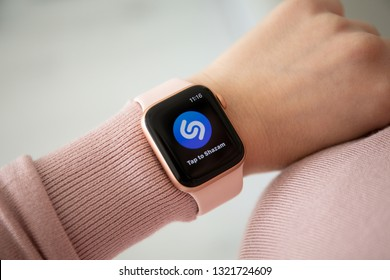 Anapa, Russia - February 16, 2019: Woman hand with Apple Watch Series 4 and music service Shazam on the screen. Apple Watch was created and developed by the Apple inc.