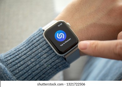 Anapa, Russia - February 17, 2019: Man hand with Apple Watch Series 4 and music service Shazam on the screen. Apple Watch was created and developed by the Apple inc.