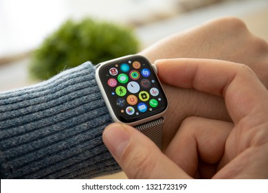 Anapa, Russia - February 17, 2019: Man hand with Apple Watch Series 4 and finger touching screen. Apple Watch was created and developed by the Apple inc.