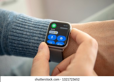 Anapa, Russia - February 17, 2019: Man hand with Apple Watch Series 4 and phone message on the screen. Apple Watch was created and developed by the Apple inc.