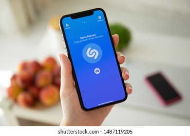 Anapa, Russia - July 22, 2019: Woman hand holding iPhone X with music service Shazam on the screen. iPhone was created and developed by the Apple inc.