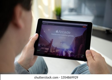 Anapa, Russia - March 29, 2019: Man hand holding iPad Pro with Apple Arcade video game subscription service on the screen. iPad Pro was created and developed by the Apple inc.