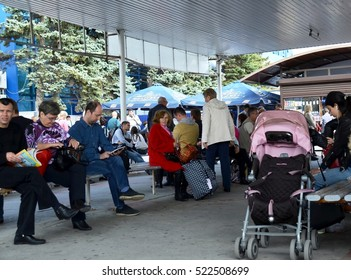 ANAPA, RUSSIA - OCTOBER 08, 2016: Passengers flying away from resort town Anapa, waiting for departure of his flight from airport in covered street Vityazevo indoor departure lounge outdoors