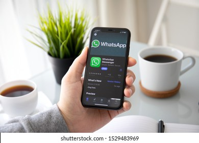 Anapa, Russia - October 3, 2019: Man holding iPhone 11 with social networking service WhatsApp on the screen. iPhone 11 was created and developed by the Apple inc.