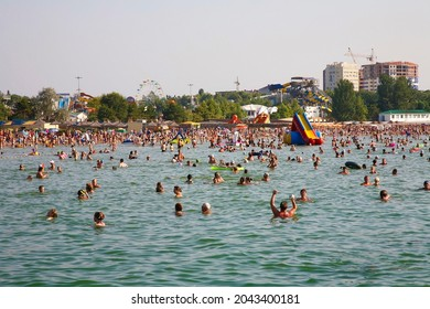 ANAPA, RUSSIA-AUGUST 07, 2010: People on the beach on the Black Sea coast in the city of Anapa on a hot summer day. Krasnodar Territory, Russia