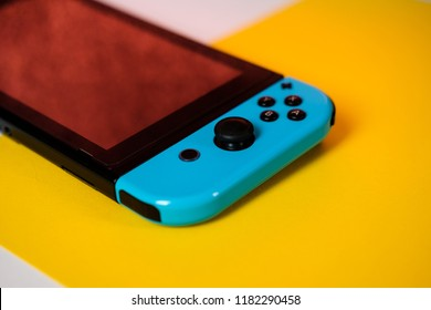 Anapa, Russian Federation - 7 September 2018,  Nintendo Switch console. handheld Nintendo Switch on yellow background
