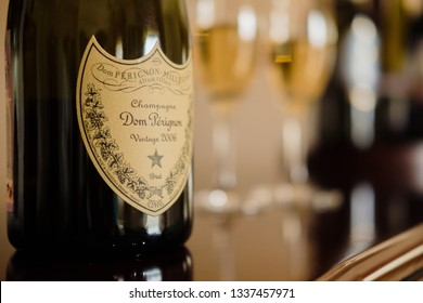 Anapa, Russian Federation - February 20, 2019 Dom Perignon. Dom Pérignon. Close up of Bottle of Champagne Dom Perignon Vintage 2006 on the background of two glasses of wine