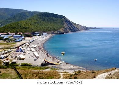"ANAPA,SUKKO, RUSSIA- AUGUST 2, 2017 ; BEACH ""SUKKO"", THE PEOPLE   ARE SWIMMING IN THE SEA ,  AUGUST 2, 2017"