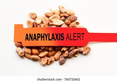 Anaphylaxis alert bracelet on top of peanuts