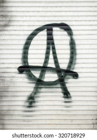 Anarchist symbol spray-painted on a shutter in Berlin, Germany.