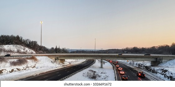 ANCASTER, CANADA - FEBRUARY 12, 2018: Traffic on the  snowy intersection of the 403 Highway and the Lincoln M. Alexander Parkway, Ancaster, Hamilton Ontario, Canada.