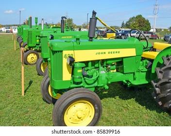 ANCASTER, ONTARIO, CANADA - SEPTEMBER 24: An assortment of vintage John Deere farm tractors on display at the Ancaster Fall Fair on September 24, 2011 in Ancaster, Ontario, Canada