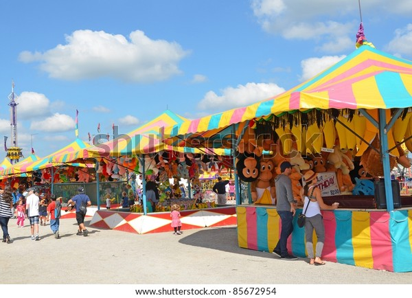 ANCASTER, ONTARIO, CANADA - SEPTEMBER 24: Fair visitors mingle around the colorful Games booth at the yearly Ancaster Fair on September 24, 2011 in Ancaster, Ontario, Canada