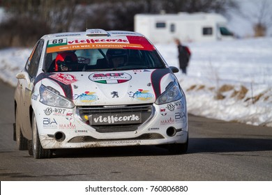 ANCELLE- FRANCE - JANUARY 23, 2016 : view of the passage of the cars of the monte carlo rally at the col de la croix, between ancelle and saint leger les melezes, south east of france