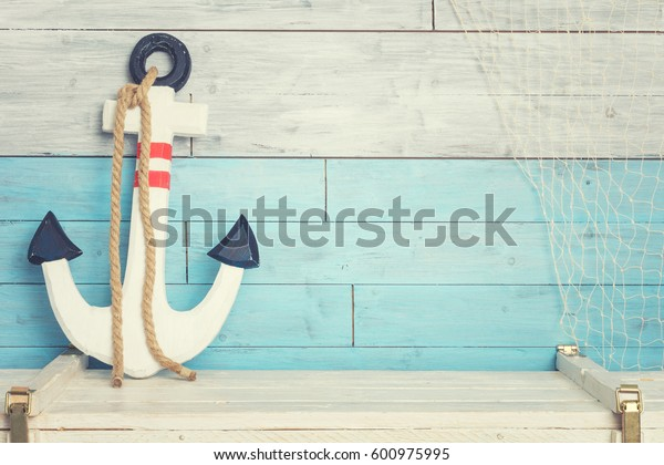 Anchor against the background of blue-white boards