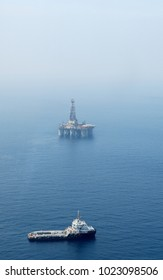 An Anchor Handling Tug Supply (AHTS) Vessel is circling around a Semi-Submersible Drilling Rig