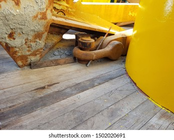 Anchor laid on deck of construction barge at oilfield